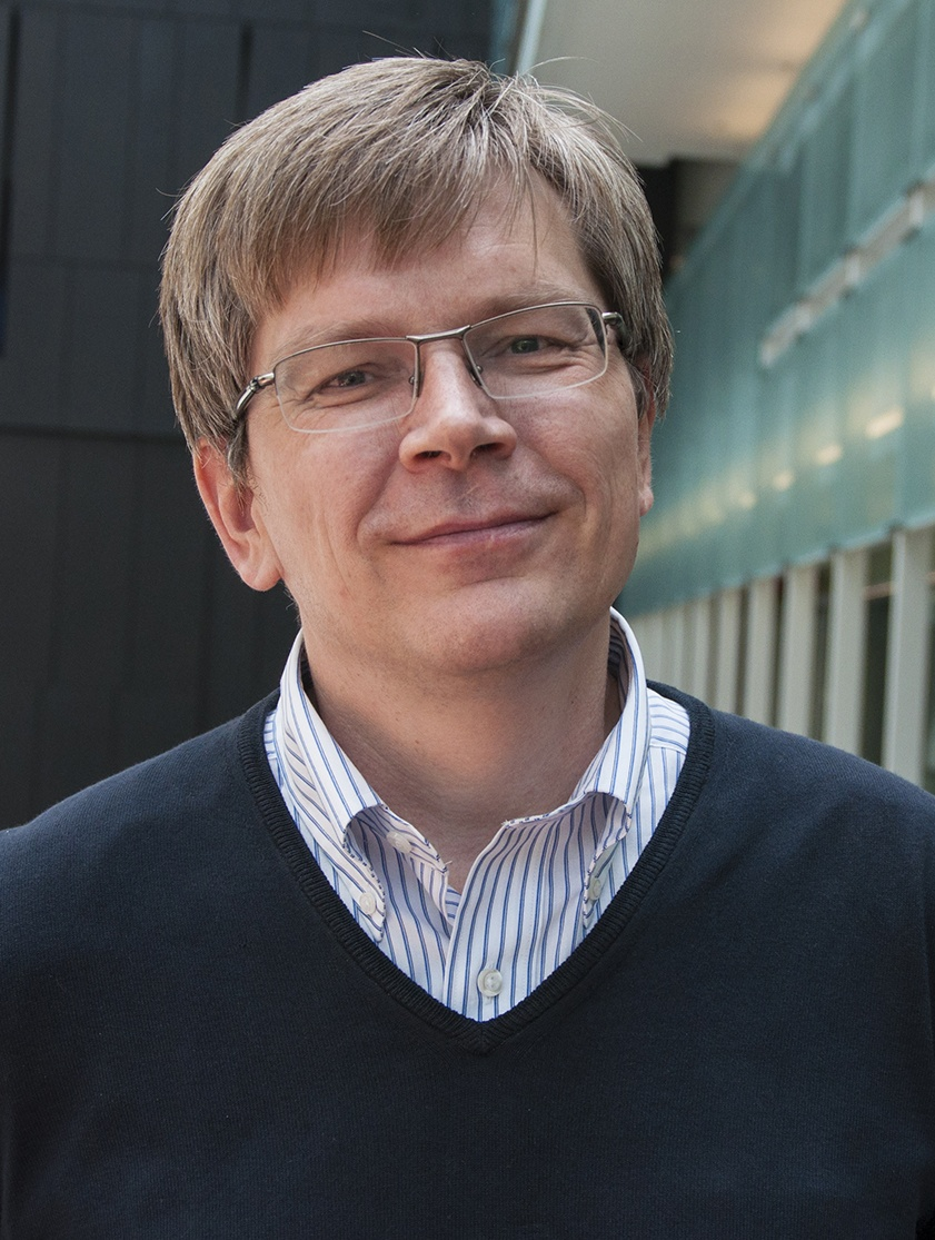 headshot of Maxim Pospelov