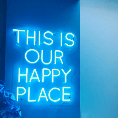LED sign that says This Is Our Happy Place