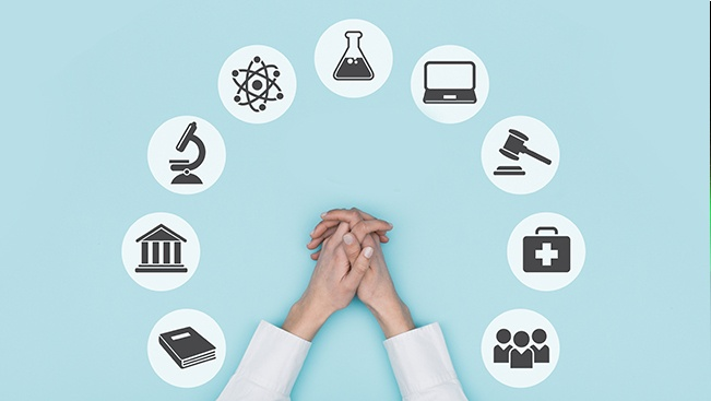 Clasped hands surrounded by icons representing careers, such as books, a microscope, a beaker, and a medical bag